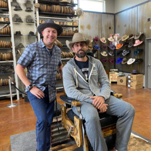 Green Bay Packers Quarterback Aaron Rodgers poses with Greeley Hat Works Owner Trent Johnson