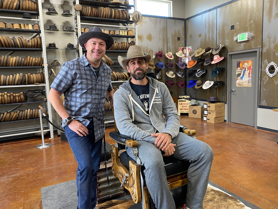 Green Bay Packers Quarterback, Aaron Rodgers, poses with Greeley Hat Works Owner, Trent Johnson.